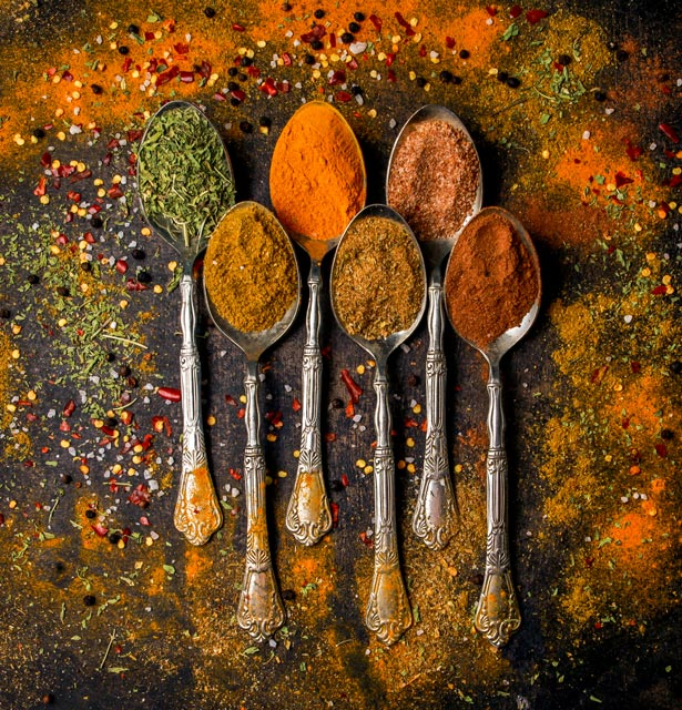 top-view-spice-with-pepper-cinnamon-turmeric-spoon